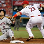 Milwaukee Brewers right fielder Ryan Braun (8) slides safely into third base in the fifth inning during the Major League Baseball game between the Cincinnati Reds and the Milwaukee Brewers, Saturday, July 4, 2015, at Great American Ball Park in Cincinnati.