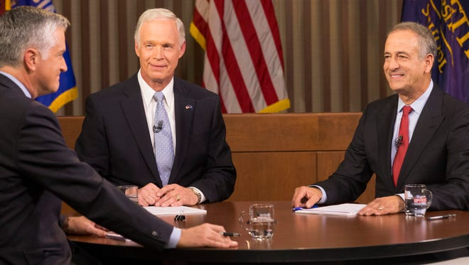 Republican U.S. Sen. Ron Johnson (left) and Democrat Russ Feingold (right) meet in their second and final debate Tuesday, Oct. 18.