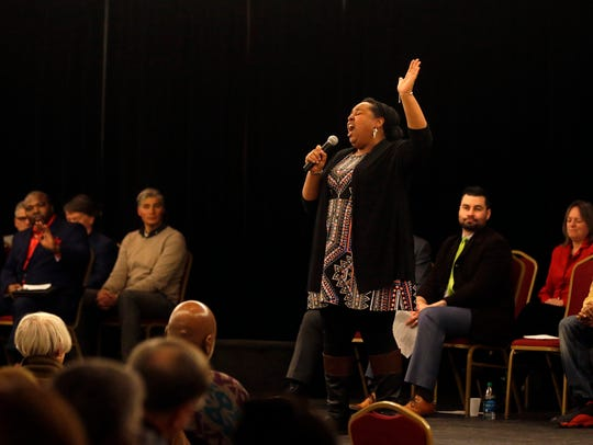 Soloist Erica Hamilton sings during a community worship