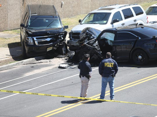 Officers view the scene of a fatal accident in Paterson involving a Paterson police vehicle.