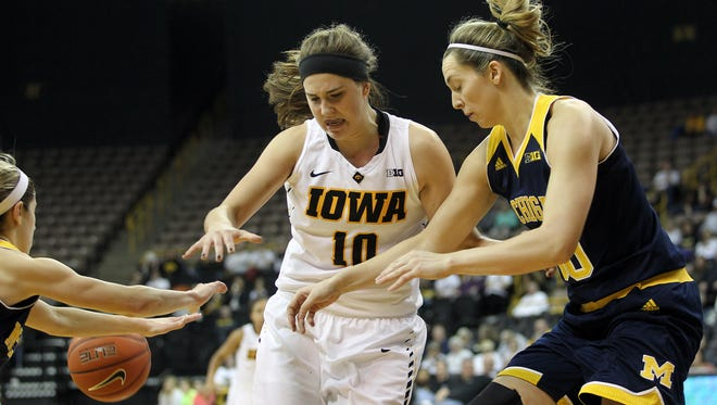 Iowa's Megan Gustafson tries to pull in a rebound during the Hawkeyes' game against Michigan at Carver-Hawkeye Arena on Thursday, Jan. 28, 2016.