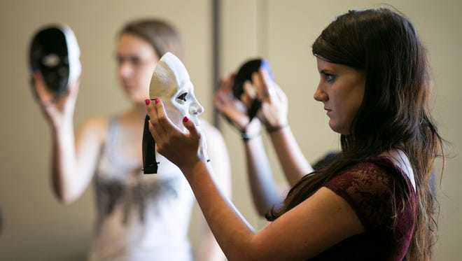 Students familiarize themselves with the features of their chosen masks during a Masks and a Physical Approach to Acting workshop at the 2016 Oregon Thespians State Festival at the Salem Convention Center on Friday, April 1, 2016. The festival drew nearly 1,300 high school students  from around Oregon to participate in competitions, showcases and workshops.