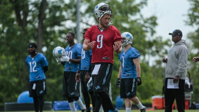 Detroit Lions quarterback Matthew Stafford talks with teammates during practice in Allen Park on June 9, 2016.