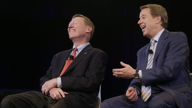 Alan Mulally retired as Ford CEO and president on July 1, 2014, and was inducted into the Automotive Hall of Fame on Thursday. He is pictured here with Ford Executive Chairman Bill Ford.