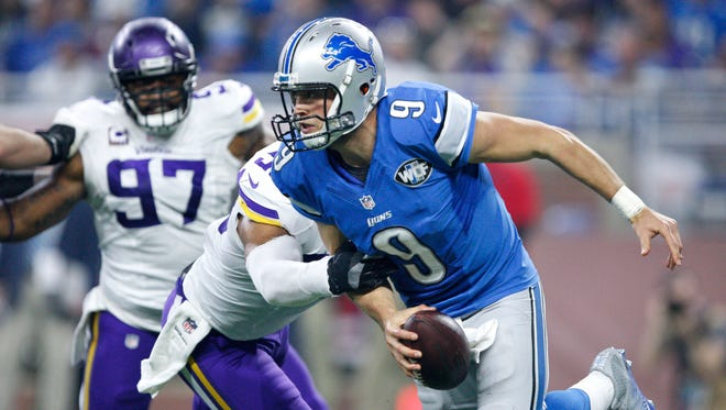 Detroit Lions quarterback Matthew Stafford (9) tries to evade pressure from the Minnesota Vikings during the fourth quarter Nov 24, 2016, at Ford Field.