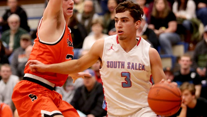 South Salem's Gavin Baughman (3) moves past Sprague's Max Long (2) in the first half of the Sprague vs. South Salem boy's basketball game at South Salem High School on Friday, Feb. 3, 2017. Sprague won the game 64-58.