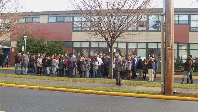 FILE: Scene at Fair lawn High School where around 50 individuals  gathered on Sunday in what was called a  rally in support of the school. The rally was organized by Adi Vaxmann as a result of the  ongoing twitter uproar.