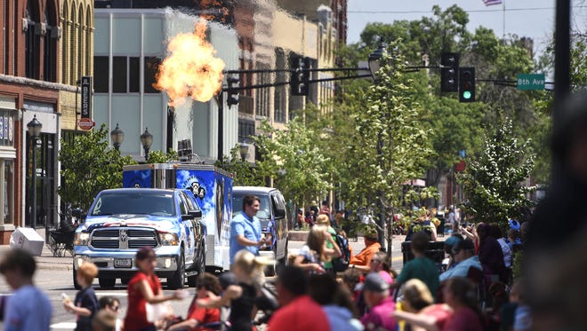 A hot-air balloon burner adds the the heat on St. Germain Street during the 2016 Granite City Days Parade in St. Cloud.