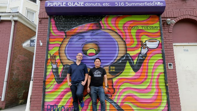 "Alex Biese, features reporter at Asbury Park Press, and Ming Chen, co-host of ""Comic Book Men"" on AMC, attempted to buy a donut at Purple Galaze, only to find the business is closed on Tuesdays, as they spend the day in Asbury Park, NJ with only $100 for ""Travel Allowance,"" a new USA Today project, Tuesday August 8, 2017."
