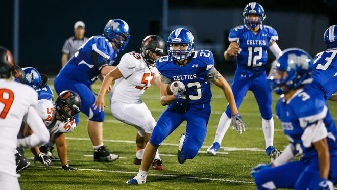 McNary's Lucas Garvey (23) carries the ball in a game against Sprague on Friday, Sept. 15, 2017, at McNary High School in Keizer, Ore. Sprague defeated McNary 62-6.