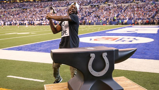 Reggie Wayne hits the anvil to get the crowd riled up before the game against the San Francisco 49ers at Lucas Oil Stadium, Sunday, Oct. 8, 2017.