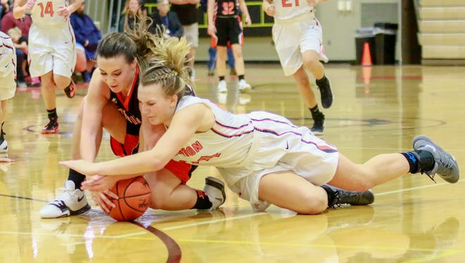 Brighton's Sophie Dziekan (right) scrambles on the floor for a loose ball with Northville's Sarah Toth.