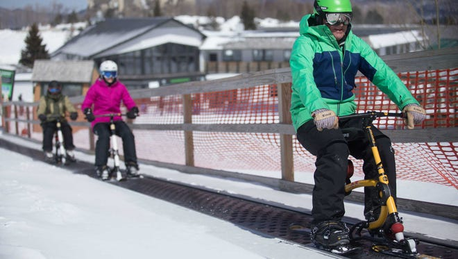 Ski bike riders get a lift up the slope at Killington Resort. Also referred to as snow-bikes, ski bike rentals and instruction are available at the Killington Snowshed base area as of December 2017.