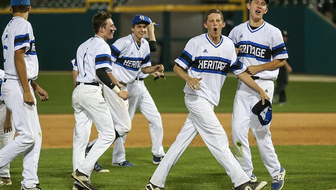 The Heritage Christian Eagles celebrate defeating Cathedral, 6-2, for the city tournament title at Victory Field in Indianapolis, Monday, May 14, 2018.