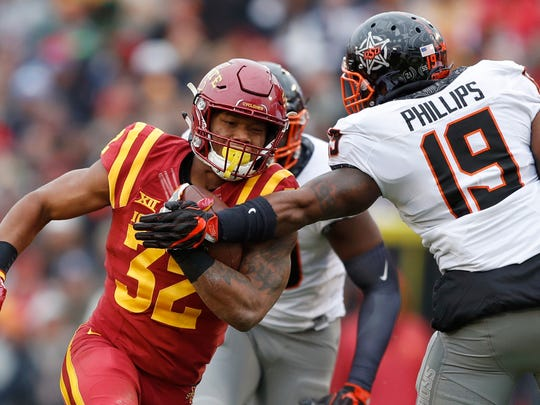 FILE - In this Nov. 11, 2017, file photo, Iowa State running back David Montgomery (32) breaks a tackle by Oklahoma State linebacker Justin Phillips (19) during the first half of an NCAA college football game, in Ames, Iowa. Memphis plays Iowa State in the Liberty Bowl on Saturday, Dec. 30. (AP Photo/Charlie Neibergall, File)