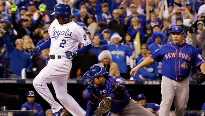 Kansas City Royals' Alcides Escobar scores during the 14th inning of Game 1 of the Major League Baseball World Series against the New York Mets Wednesday, Oct. 28, 2015, in Kansas City, Mo. The Royals won 5-4 to take a 1-0 lead in the series. (AP Photo/David J. Phillip)