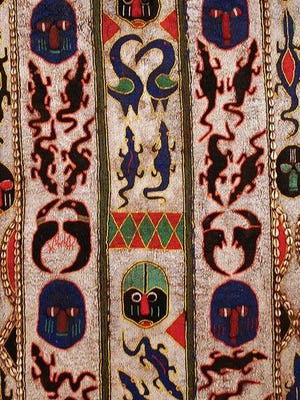 A detail from a 20th-century Yoruba priest's tunic from Nigeria. Gift of Martha and Robert Fogelman.