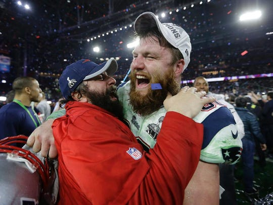 Former New England Patriots center Bryan Stork, shown celebrating with Patriots defensive coordinator Matt Patricia after winning Super Bowl XLIX, retired from the NFL on Tuesday, March 21, 2017.