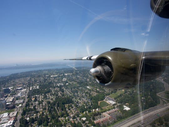 A restored World War II-era B-25 bomber overflies Bellevue,