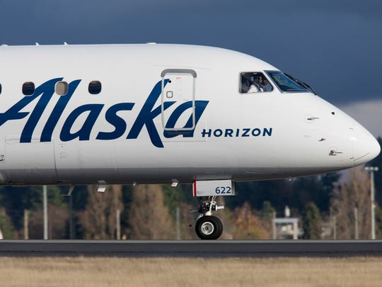 A Horizon-operated Embraer E170 jet, flying for Alaska Airlines, lands at Seattle-Tacoma International Airport in December 2017.