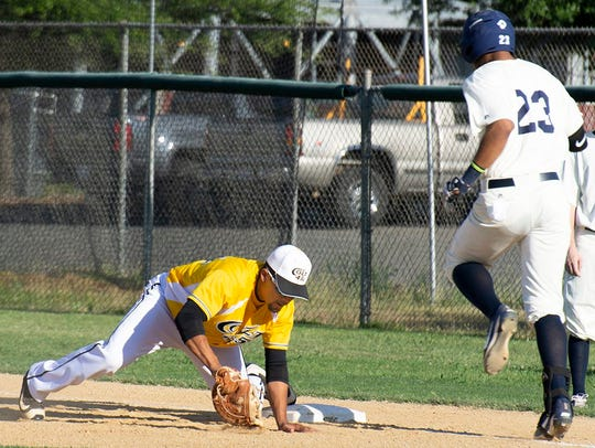 Colt 45s' first baseman Marcus Wilhite digs out a low