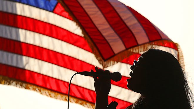 Yvetta Dominique sings the national anthem during the MAy 2017 Tribute to America?s Heroes event at Centennial  Park in downtown Fort Myers. The 2018 event was canceled due to subtropical Storm Alberto.