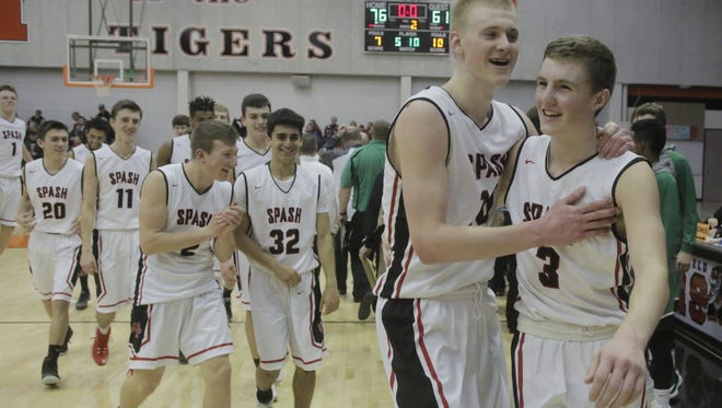 Stevens Point Area Senior High's Joey Hauser, left, and Drew Blair celebrate a win over Oshkosh North in a WIAA Division 1 sectional final earlier this month.  Hauser and Blair were both first team All-State selections by the Wisconsin Basketball Coaches Association.