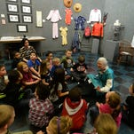 Volunteer Bess Sturgis, right, talks to kindergarten students and teachers from Crestdale Elementary School about China during Art is China, Wednesday, March 25, 2015, at the Richmond Art Museum.