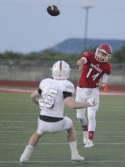 Jim Ned quarterback Coalby Rives (14) throws a pass during the Indians' 32-28 loss to Sonora on Friday at Indian Stadium.