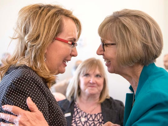 Former Congresswoman Gabrielle Giffords (left) shares