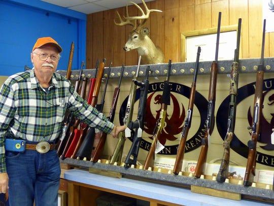 David Dinkela with his display of Ruger firearms.