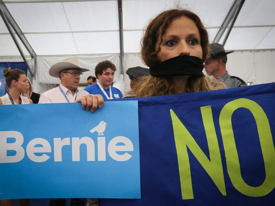Bernie Sanders supporters stage a protest in the media