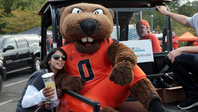 Oregon State Beavers fans poses for a picture with Oregon State Beavers mascot Bennie the Beaver before the game against the Stanford Cardinal at Reser Stadium.