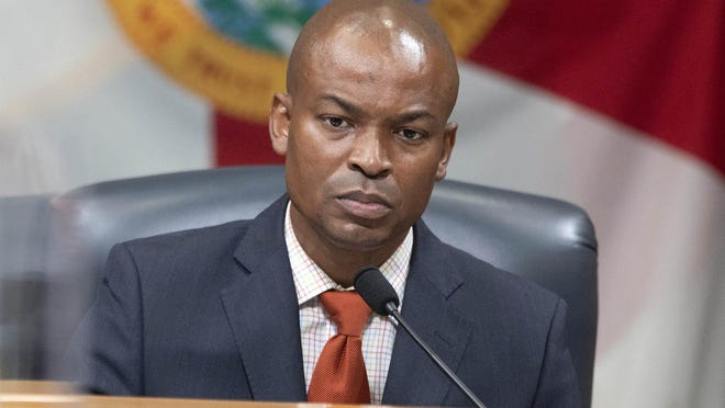 Palm Beach County Commissioner Mack Bernard listens Tuesday to a report from the county's health director, Dr. Alina Alonso.