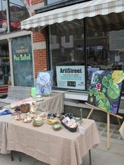 Artists will line the sidewalks in the Carousel District