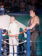 "Andre the Giant makes his way to the ring, along with manager Bobby ""The Brain"" Heenan. The villains were pelted by trash from fans, both heading to and from the ring."