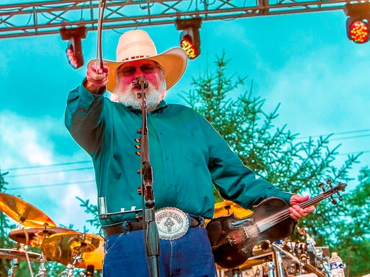 """Charlie Daniels is promoting a new memoir, """"Never Look at the Empty Seats,"""" and a new album, """"Night Hawk."""" He headlines the Rock, Ribs and Ridges Festival at the Sussex County Fairgrounds in Augusta on Saturday"""
