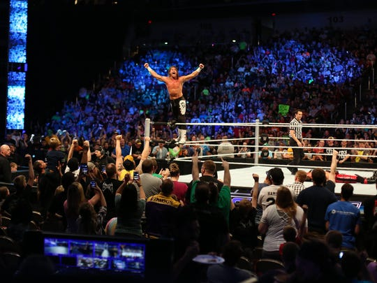 WWE wrestler Dolph Ziggler plays to the crowd during