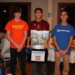 Super Smash Bros. winner Jake Corpus, center, with Patrick Santorella-Doyle, left, and Mark Lenac. Santorella-Doyle is wearing an orange 'Change Forever' shirt from the 2012 student leadership conference.