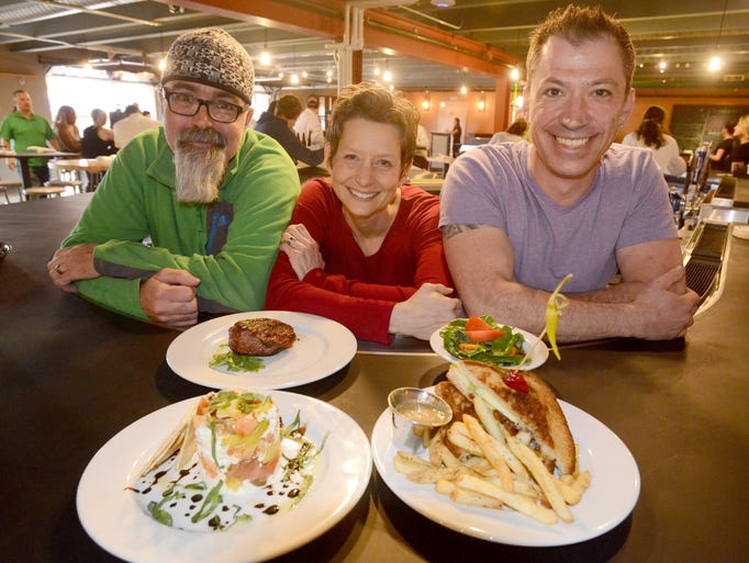 Owners of the Laboratory from let, David Rose, Angela King, and Jeff Leef on the restaurants opening day Thursday May 15, 2014.