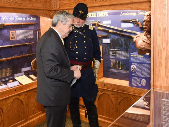 Gov. Terry Branstad talks with Tom Clegg, a Civil War reenactment participant, at Camp Dodge's Iowa Gold Star Military Museum.