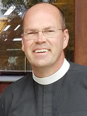 Episcopal Diocese of East Tennessee Bishop-elect Brian Lee Cole stands outside the Diocesan House in West Knoxville, where, in the weeks preceding his ordination as bishop, he has been working alongside retiring Bishop George Young.