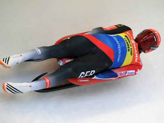 FILE - In this Jan. 28, 2018, file photo, Germany's Felix Loch speeds down the track during a men's race at the Luge World Cup event in Sigulda, Latvia. German greats Natalie Geisenberger and Felix Loch are the reigning Olympic gold medalists, and the favorites to win more gold in luge at the Pyeongchang Games. (AP Photo/Roman Koksarov, File)