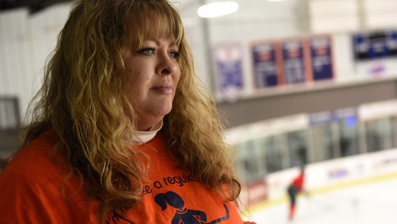 Angela Drake becomes emotional while watching the Sioux