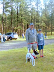 Lincoln County Commissioner Dallas Draper, his son and their dog turned out for the walk.