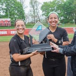 Binghamton University captains Caytlin Friis, left, and Griffin McIver, a Union-Endicott graduate, receive the America East Conference championship trophy from the conference's Director of Communications Sean Tainsh at Stony Brook in May 2015.