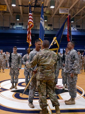 Lt. Col. Richard Hanes, the incoming commander of the Louisiana National Guard's 3rd Battalion, 156th Infantry Regiment, 256th Infantry Brigade Combat Team, receives the unit colors from Maj. Gen. Glenn H. Curtis, adjutant general of the Louisiana National Guard, during an official change of command ceremony at Barbe High School in Lake Charles, La., May 14, 2016.  Hanes is currently assigned full time as the 3-156th's administrative officer as well as being the battalion commander. (U.S. Army National Guard photo by Sgt. Noshoba Davis)