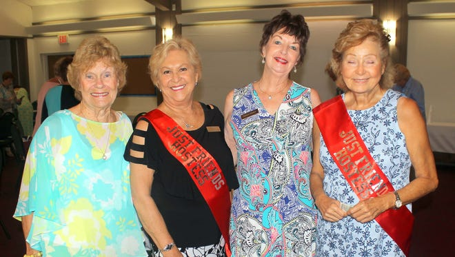 MaryAnn Cassidy, Bonnie Bozzo, Dianne Wetjen and Patty Terreri welcome members as they arrive to lunch.