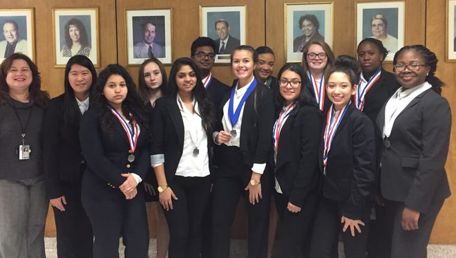 (From left) Angela D'Ottavio, advisor, Vineland High School chapter of the Health Occupation Students of America, and chapter members, who won medals, Amy Antonio, Raesha Campbell, Ezriella Chaniz-Rico, Fradely Delacruz, Krystal Salaberrios-Gonzalez, Gehana Gupta, Sally Lu, Vadant Patel, Alexis Pineda, Magellan Rankin, Kayleigh Rivera, and Honor Whiteside are pictured at the Southern Regional Conference of the Health Occupation Students of America.