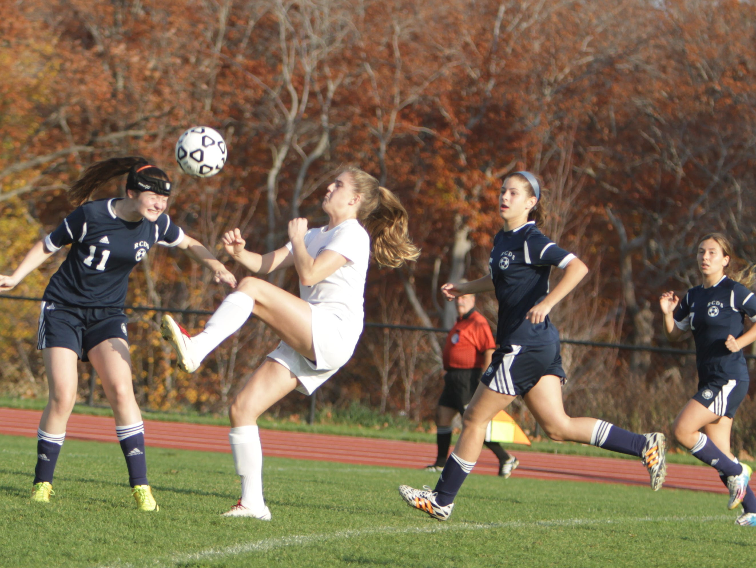 Rye Country Day's Madeline Zuber heads the ball away from Hackley's Sammy Mueller during a NYSAIS semifinal match at the Hackley School on Friday, November 6th, 2015. Hackley won 3-1.